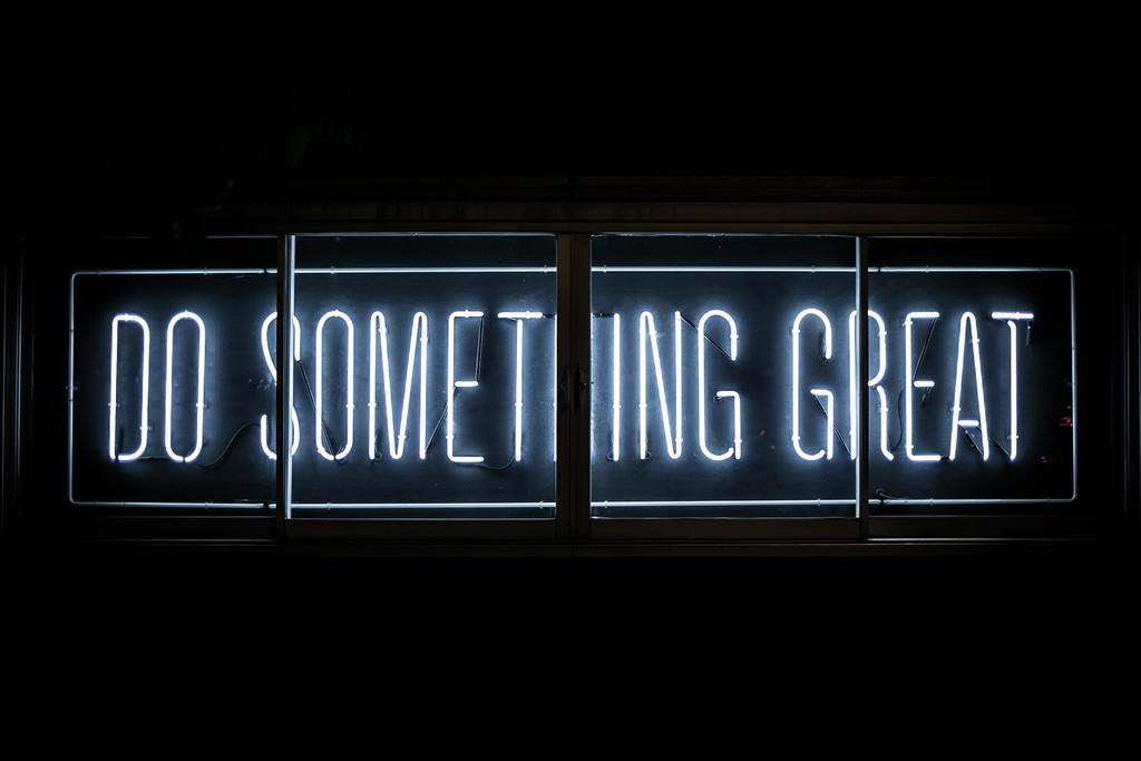 Image of white neon sign with the t3ext :do something great: