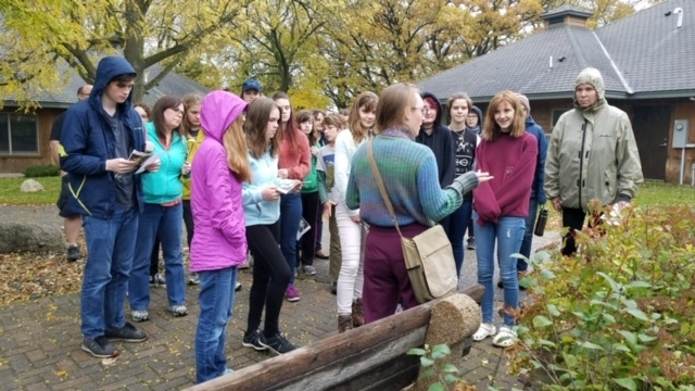 Student leading a walk and learn about lichen at Fall Celebration