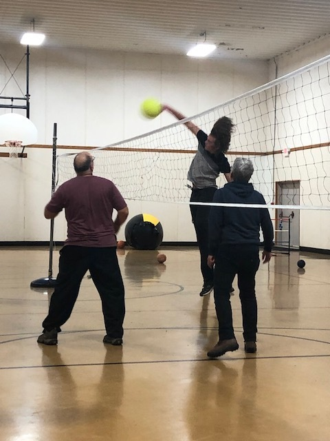 Student spikes the ball in a volleyball game