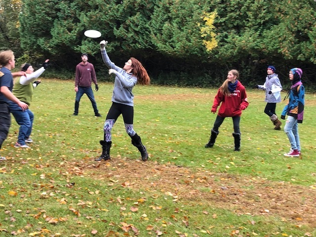 Action shot of a student catching a frisbee in ultimate frisbee