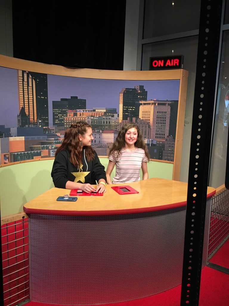 Students at newscasting desk