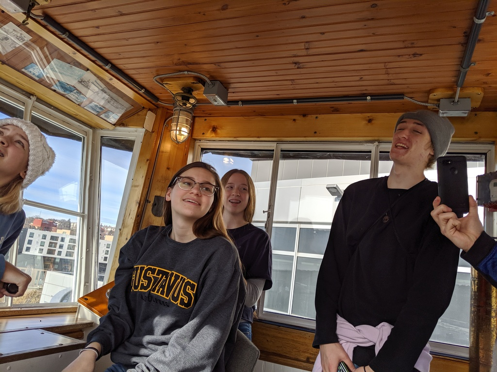 Students on captains deck of tugboar