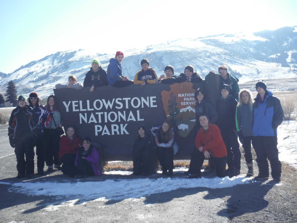 Image of students at Yellowstone National Park Sign